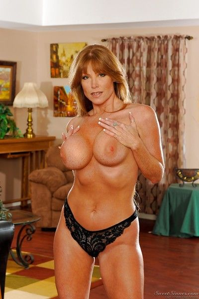 Busty MILF stunner Darla Crane strips out of her black lingerie