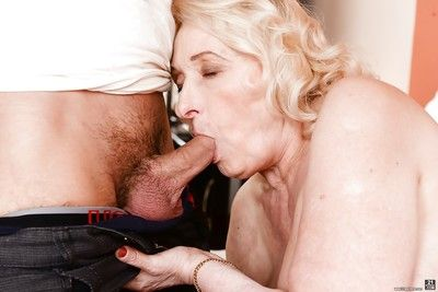 Blonde granny in lingerie giving handjob and bj before cumshot in mouth
