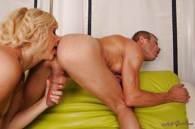 Lewd granny gobbles and fucks a young cock for a huge facial load