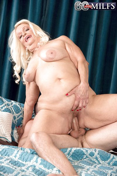 Blonde granny Vikki Vaughn loosing saggy boobs to seduce younger man for sex