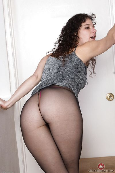 Mature solo model Sunshine releasing really hairy cunt from pantyhose