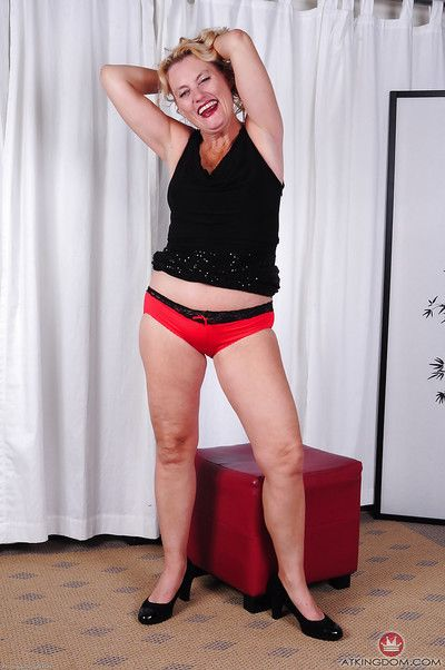 Mature blonde dame Lady Dalbin stripping naked to spread shaved granny twat