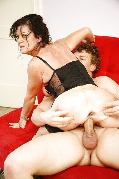 Cock-starving granny in stockings De Bella has some double penetrated fun