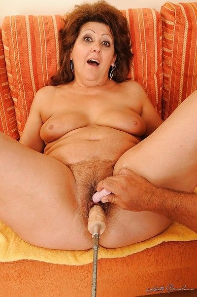 Full-figured granny gets her pussy fucked by a machine and a younger guy