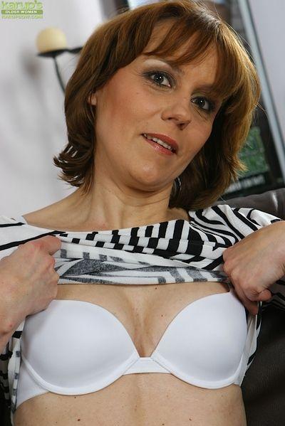 Mature lady Mylene flashing white upskirt undies before spreading pussy