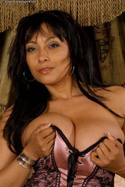Amateur mature model in satin lingerie baring big beasts & fingering pussy