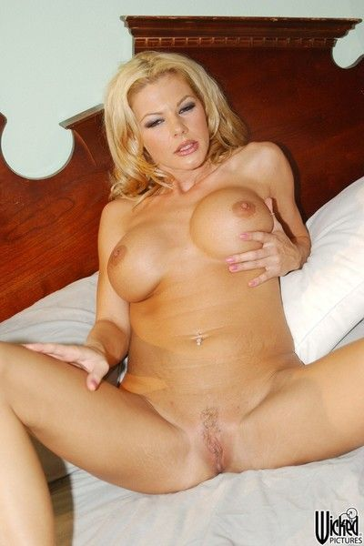 The gorgeous blonde milf Kim Chambers proudly demonstrates hot huge melons