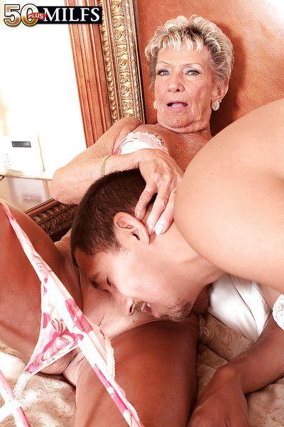 Lustful granny Sandra Ann getting her shaved mature cunt banged hard