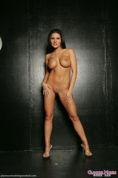 Big jugged brunette Austin Kincaid takes off her lingerie to pose in her birthday suit