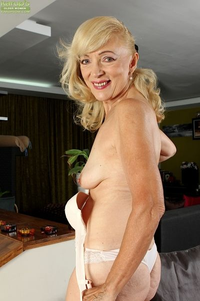 Horny granny Janet Lesley bares saggy tits & spreads wet pussy wide open