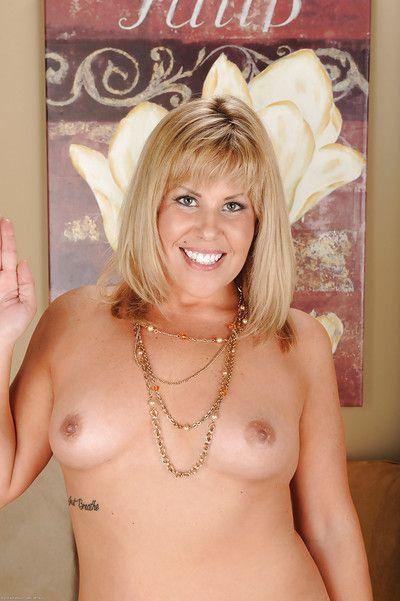 Mature blonde Kayla Larson posing shaved slit in black thong panties