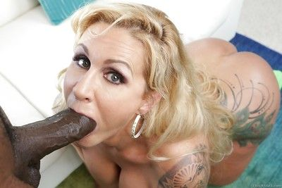 Older blonde Ryan Conner giving massive black dick interracial BJ on knees