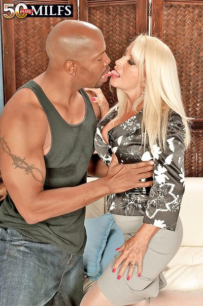 Mature blonde Julia Butt revealing puffy melons and mounting black dick