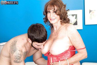 Lingerie attired granny Jacqueline Jolie giving blowjob before having sex