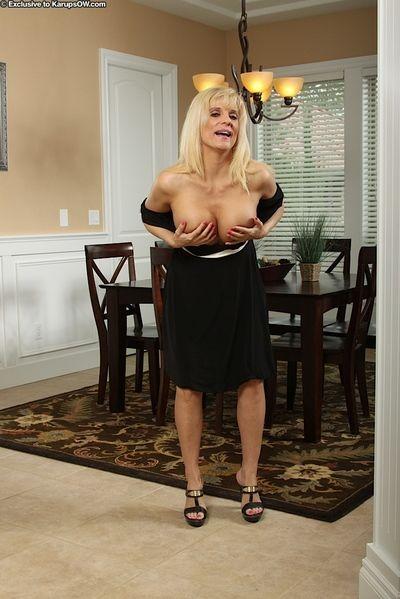 Older blonde broad Jess Jameson shedding black dress to model naked in heels