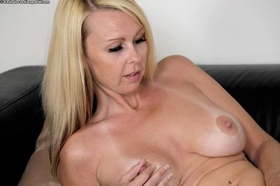 Older blonde lady Kylie Deville revealing big boobs before masturbating
