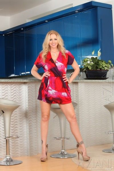 Hot milf Julia Ann with massive melons gets completely naked before she dildos her love hole