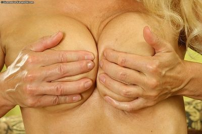 Lustful mature blonde undressing and stretching her cunt with her fingers