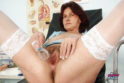 Horny granny showing her flabby tits and masturbating her hairy twat