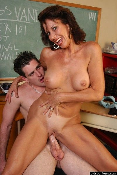 Hot mature teacher Vanesa fucks with one of her horny students in a classroom