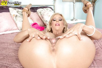 Busty older blonde Alexis Fawx spreading pink pussy while masturbating