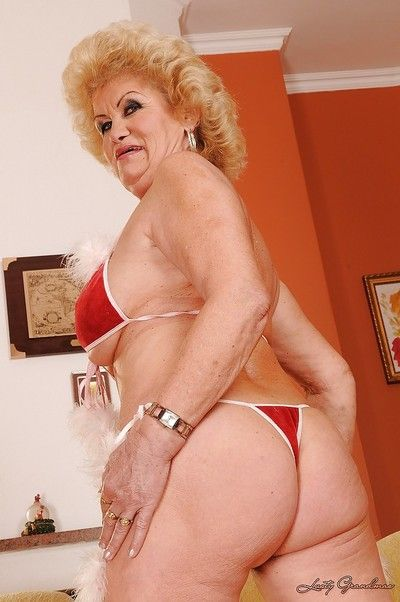 Filthy granny with big jugs and ample ass stripping off her bikini