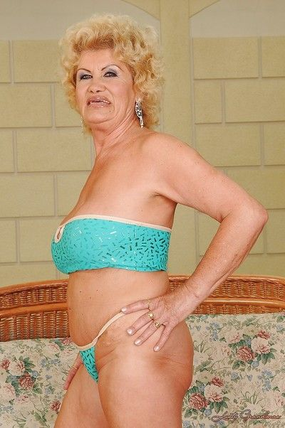 Big busted granny in lingerie stripping and showcasing her gloryhole
