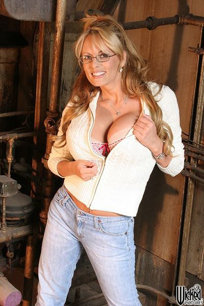Busty milf Stormy Daniels is wearing the exciting outfit and then stripping