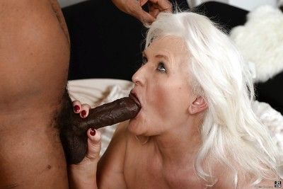 Fat granny Judi banging big black dick during hardcore interracial sex