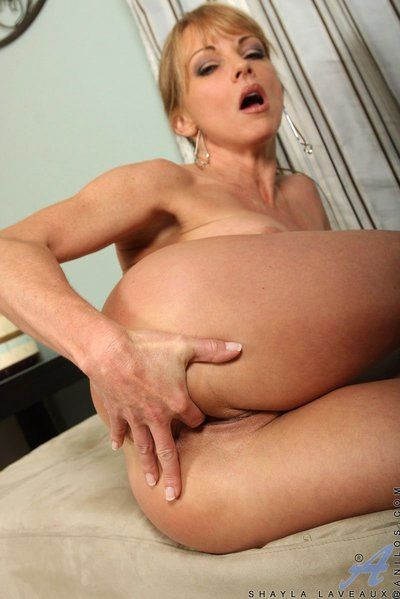 The beautiful blonde milf Shayla Laveaux tenderlt petting her own naked body