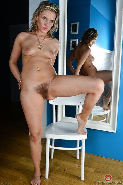 Leggy aged lady Regina slipping of hose and panties before spreading bush
