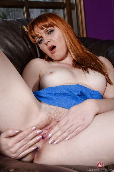 Older redhead Marie McCray slipping off panties to pet hairy pussy