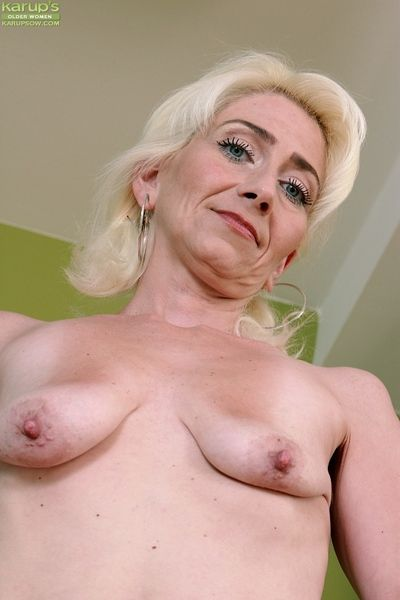 Skinny granny Janotova undressing for masturbation of shaved cunt