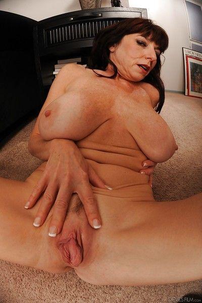 Big tits mature Karen Kougar reveals her ass in sexy stockings