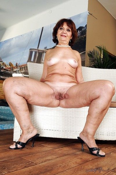 Fatty granny on high heels stripping and spreading her legs