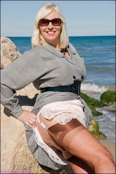 Fatty granny in stockings and glasses exposing her massive hooters outdoor