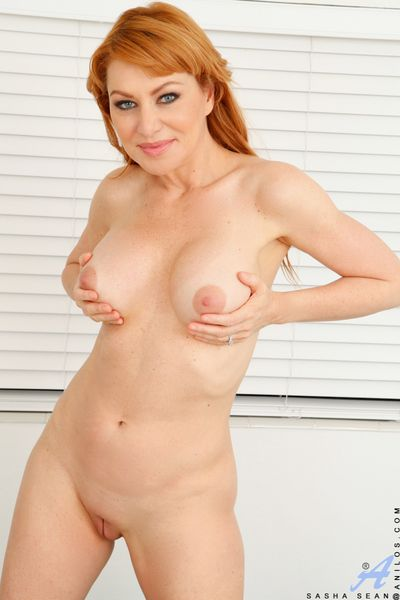 Fully clothed redhead mom strips & spreads pussy for hot masturbation