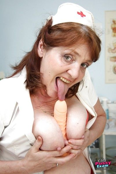 Busty granny in stockings licking her hard nipples and toying her twat