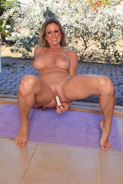 Aged dame Jade Jamison revealing big tits before inserting vibrator in cunt