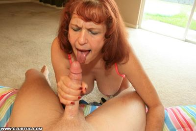 Lascivious granny with big tits sucks and strokes a young cock