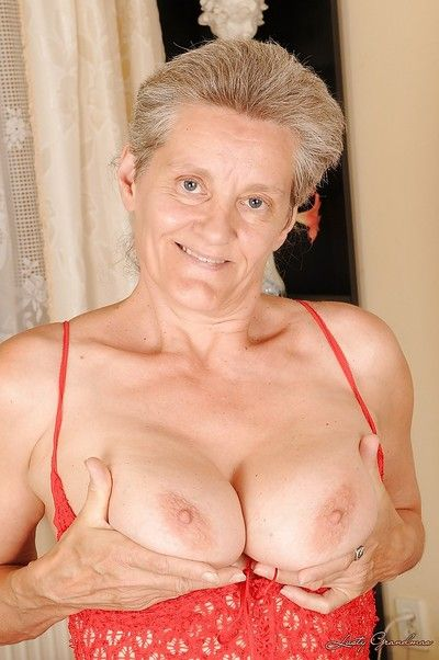 Raunchy granny with massive jugs stripping and spreading her legs