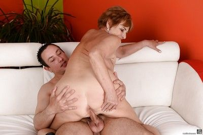 Redhead gran Sally G giving younger man oral sex and rimjob before fucking