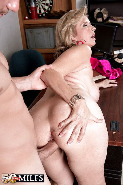 Chubby aged blonde Laura Layne having big boobs loosed and banging big dick