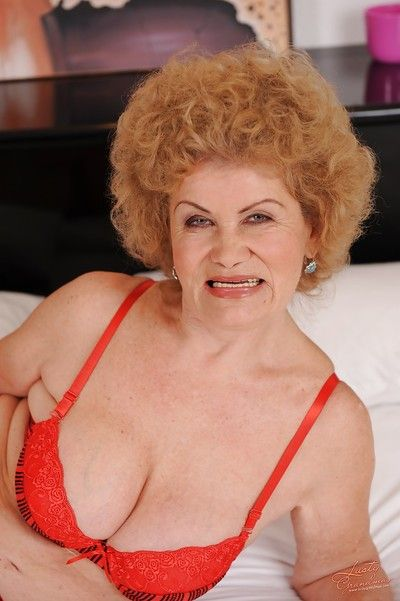 Lecherous granny taking off her lingerie and masturbating her bush