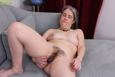 Grey haired granny Lexy Lou toying hairy vagina while masturbating