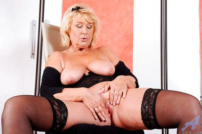 Mature busty granny Regie is spreading her pussy ready for a fuck