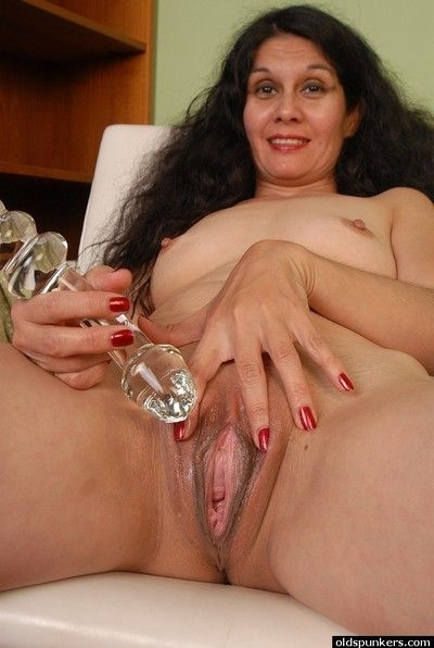 Beauty granny Carmen is playing with her lovely plastic dildo