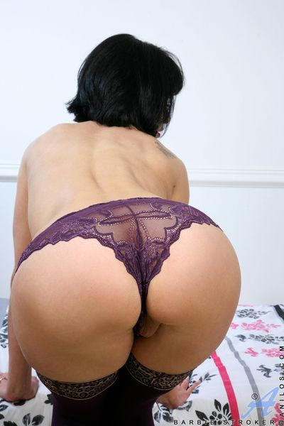 Mature lady in stockings slipping off panties for toying off horny pussy