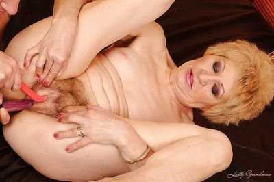 Granny with a hairy cunt spreading her legs to get a huge dick inside