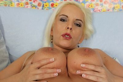 Bosomy mature woman Sandy Figgs orgasming with fingers in shaved cunt